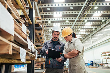 Warehousing employees utilizing custom automation software