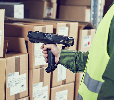 Employee scanning a box